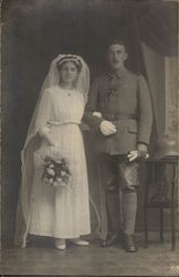 Bride in White Dress with Bouquet and Soldier in Uniform