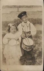 Little Girl with Doll Puppet, Little Boy With Marching Drum
