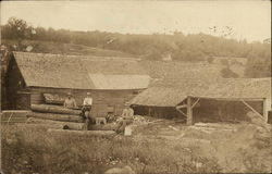 Men Cutting Logs on Farm