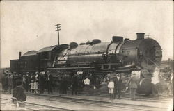People Standing on Tracks Near Large Black Locomotive Erie