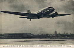 Mainliner Taking Off, Empire State Building in Background - La Guardia Airport