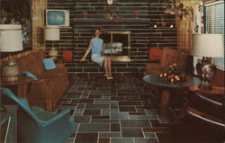 Hilltop Slate Company - Woman Sitting in Front of Fireplace