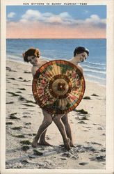 Sun Bathers in Sunny Florida - Two Women Behind Umbrella