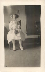 Snapshot of Girl Holding Doll