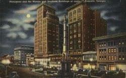 Monument and the Marion and Southern Buildings at night