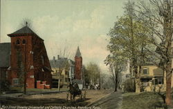 Main Street Showing Universalist and Catholic Churches Postcard