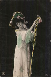 Woman Wearing Large Hat, Lacy Dress, Holding Tall Stick