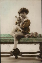 Young Child Holding a Cat