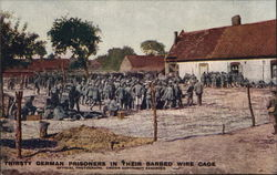 Thirsty German Prisoners in Their Barbed Wire Cage POW