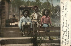 Three Black Boys on Fence
