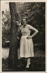 Hansi Preisinger Leaning Against a Tree