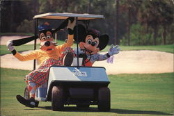 Mickey Mouse and Goofy in a Golf Cart