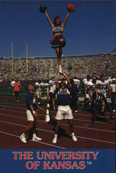 KU Cheerleaders in Dramatic Formation