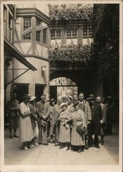 Unidentified Men and Women Before an Archway