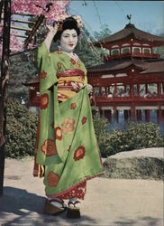 Japanese Woman Under a Cherry Blossom Tree