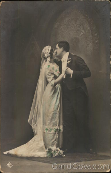 Couple Kissing and Dressed for Marriage Marriage & Wedding