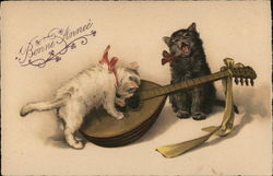 Two Kittens Playing on Mandolin