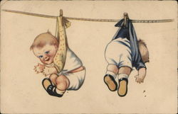Two Babies Hanging From Clothesline