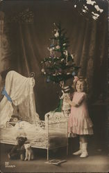 Girl Playing Dolls By Christmas Tree
