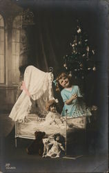 Girl Playing With Dolls Christmas Tree