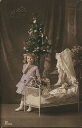 Girl Playing with Doll by Christmas Tree