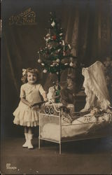 Pretty Girl with Doll in front of Christmas Tree