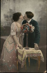 Couple Kissing next to Flowers