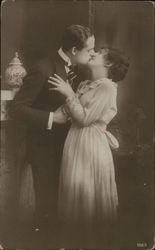 Couple Embracing in a Kiss