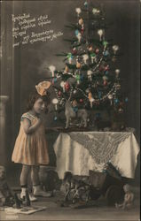 Little Girl in front of Christmas Tree