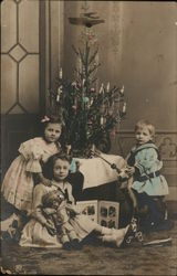 Young Children in front of Christmas Tree