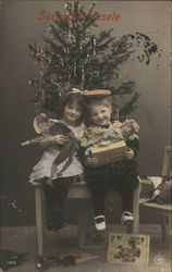 Children With Presents Under Christmas Tree