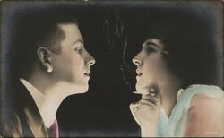 Close Up of Woman Holding Cigarette and Man Gazing at Each Other