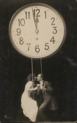 A Man and a Woman Kissing under a Clock Postcard