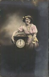 Woman Standing Next to Clock