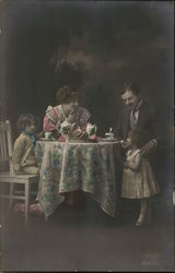 A Man, Woman and 2 Kids Having Tea