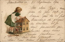 Young Girl Cleaning Dollhouse