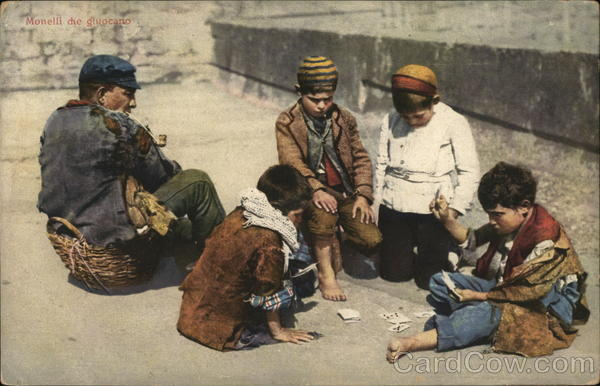 Man Seated on Basket Near Four Boys Playing Cards Card Games
