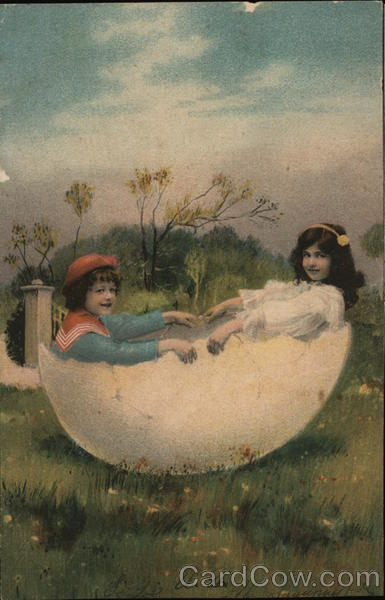 Boy and Girl Seated in Giant Egg With Children