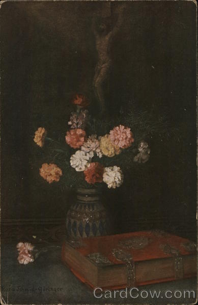 Bouquet of Multi-Colored Flowers Near Crucifix and Large Book