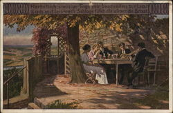Men and Women Seated at Table, Dining Outdoors Near Tree