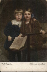 A boy and a girl with a book in her hand