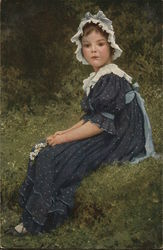 Girl in Blue Dress and White Hat Seated on Grass