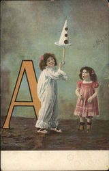 "Two Little Girls Near Large Letter ""A"""