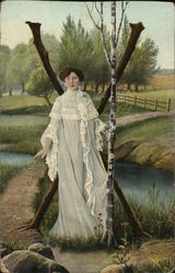 Letter X Woman Wearing White Dress along Creek Bank