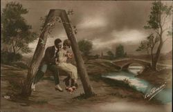 "Letter ""A"" Man and Woman Perched on Piece of Wood Romantically"