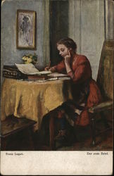 Girl Wearing Orange Dress Seated at Table Writing