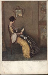 Young Woman Wearing Gold Dress in Chair Reading a Book