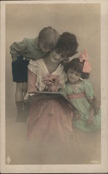 Woman reading a book with Children
