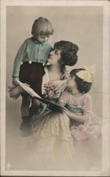 Woman with Two Children Holding Book