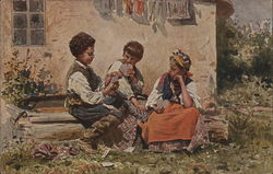 Three children playing cards